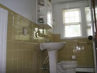How to Cover Dated Bathroom Tile with Wainscoting | Old ...