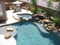 Pretty backyard pool with landscaping