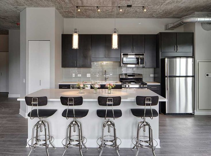 Gorgeous model kitchen featuring stainless steel GE ENERGY