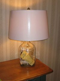 Made lamp from a jug and used to display old ticket stubs ...