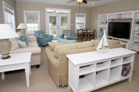 Tan, white, and sea blue beach house living room with ...