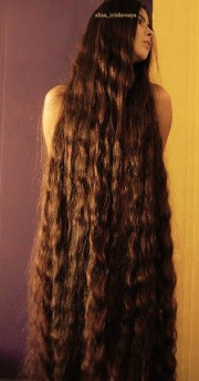extremely long thick hair. wavy