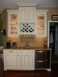 Cute built in wine rack and glass light up cabinets, but I ...