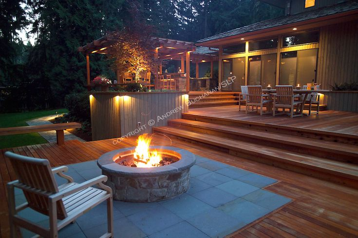 A 1700 square foot 2level deck outdoor kitchen and firepit complete the outside of this