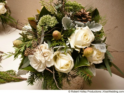 Winter Centerpiece With Evergreens White Roses And Pine