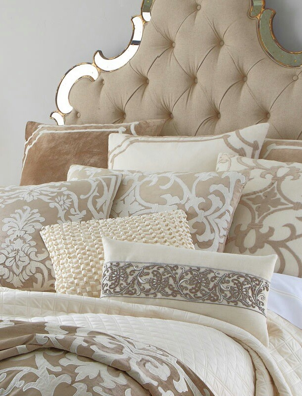 Tufted headboard and lots of pillows in different shapes