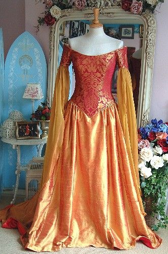 Medieval Pandora Gown with red/gold corset bodice, chiffon hanging sleeves, and matching silk skirt.  From Rossetti Costumes and Bridal
