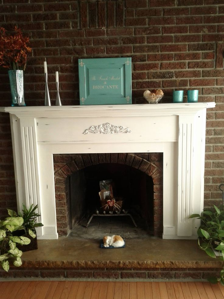 A beautiful fireplace mantel using Annie Sloans chalk paint pure white Paris grey and