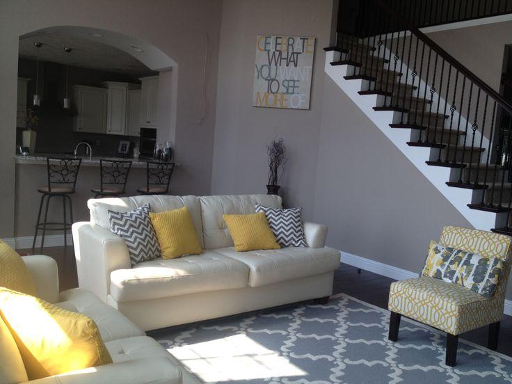 Yellow And Gray Living Room. Trellis Rug. Chevron Pillows