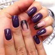 dark purple nails with lace accent