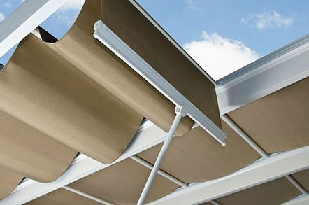 Trex Pergola with ShadeTree Canopy offers 100 shade coverage for hot summer days The
