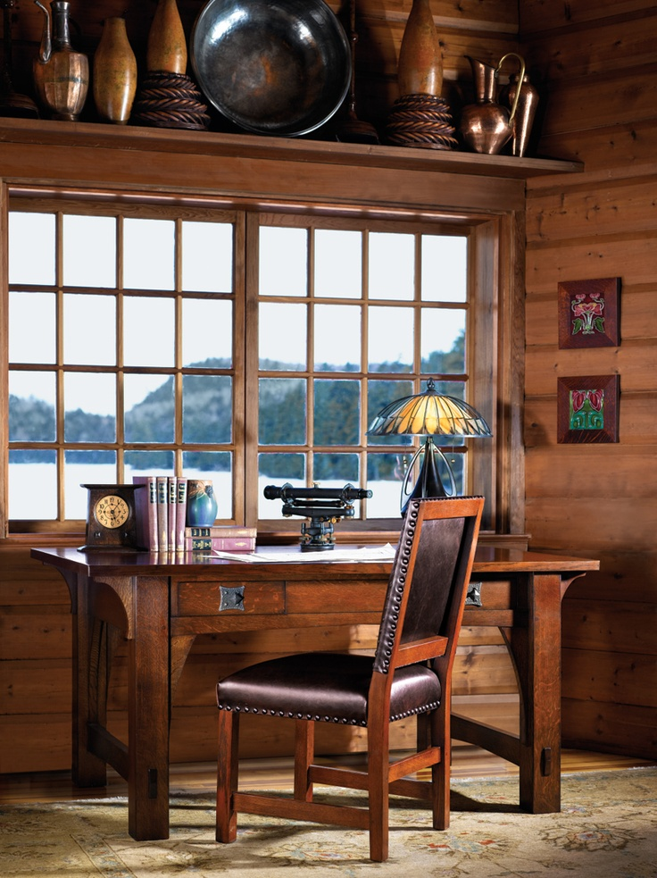 Craftsman cabin by the lake with Stickley Mission library