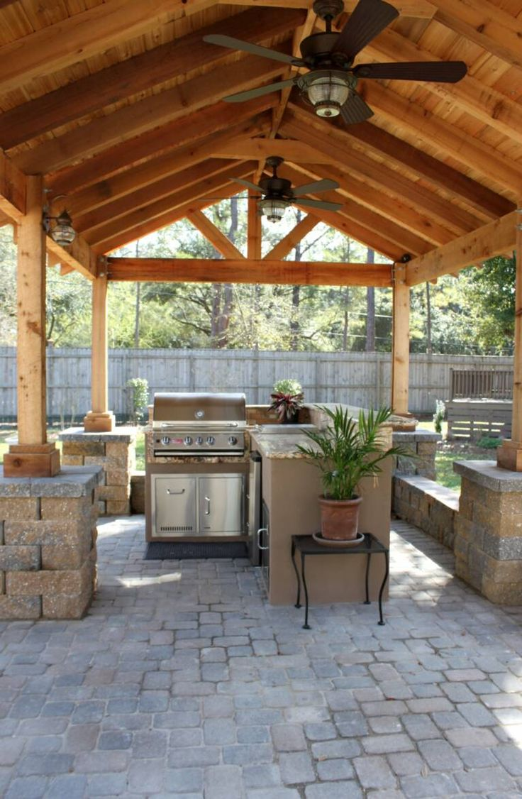 Outdoor Patio With Peaked Roof And Fans Except Over A