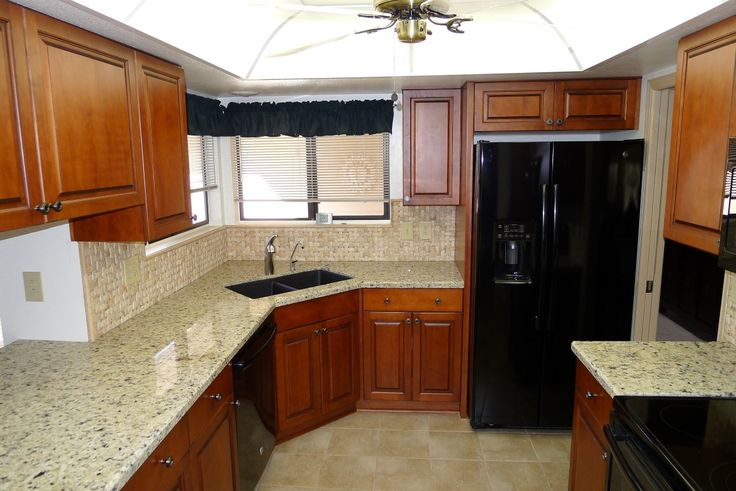 Maple Ultracraft cabinets in Fairlawn door style with a