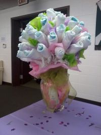 such a cool babyshower gift idea! diaper vase:)
