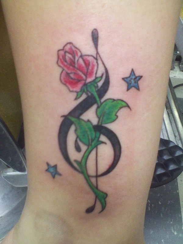 20 Butterfly With Roses And Music Notes Tattoos Ideas And Designs