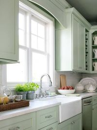 Sea foam green painted cabinets. White subway tile ...