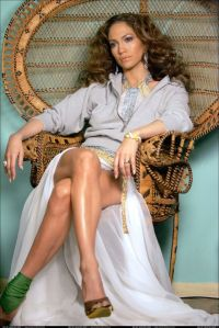 Love that chair that the lovely Jennifer Lopez is sitting ...