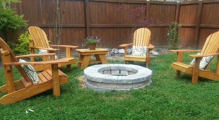 Adirondack chairs around fire pit.