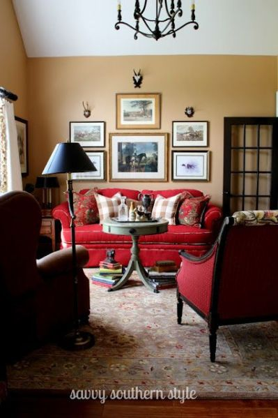 red living room Savvy Southern Style: beautiful red couches and print