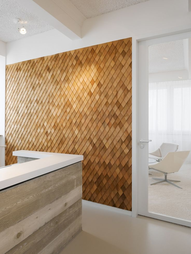 Wood shingle wall in the office space of the design agency