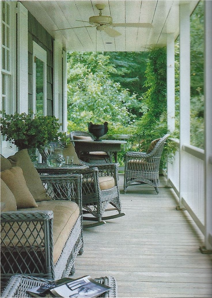 Porch wicker painted a pretty bluegray with dining at one end  Nancy Braithwaite  Old