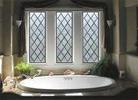 Diamond shaped stained glass bathroom window provides ...
