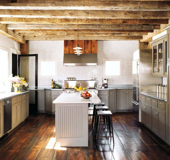 wood beam ceiling & hardwood floors along with the cabinet color and no upper cabs by the stove.