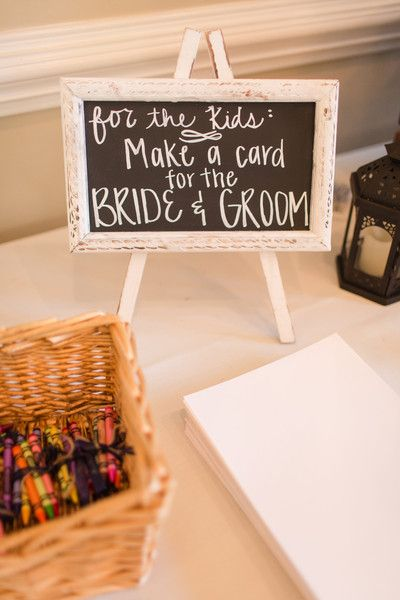 Kids table idea – crayons + paper to make a card for the bride + groom {Amber Rhod