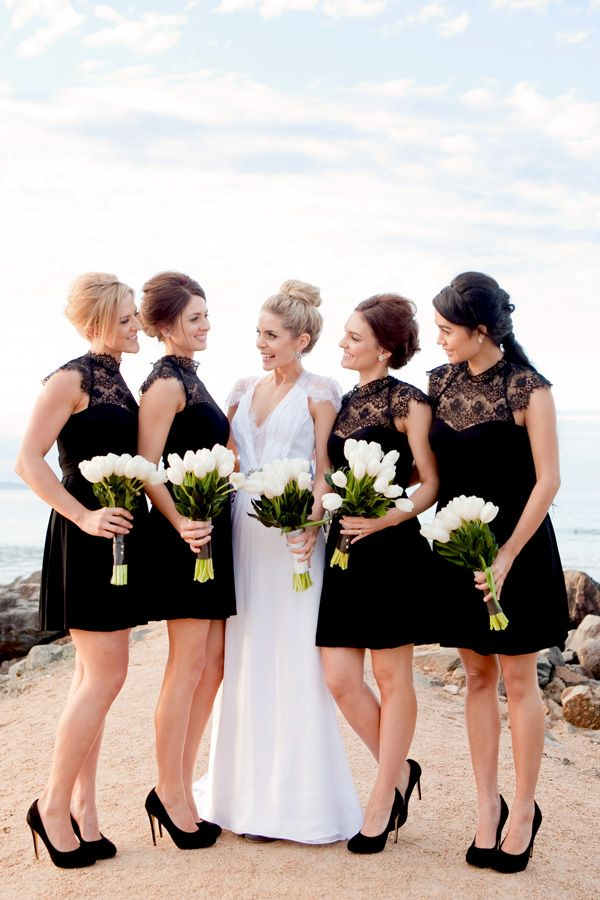 Black and white wedding – bridesmaids in black with white bouquets. Photo by Karen Buckle.
