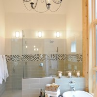 Walk-in shower, glass half wall, natural wood trim ...