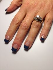 navy blue nail tips with glitter