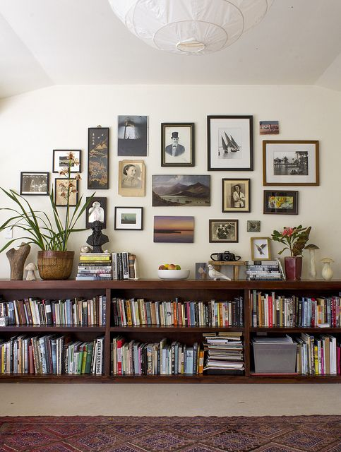 Floating bookshelves, a gallery wall and eclectic