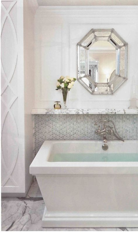 I'd be striking my knees against that tub every morning, but the mirror is lovely. Like that wall treatment to the side, too.: