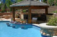 outdoor kitchens with swim up bars | pool with swim up bar ...