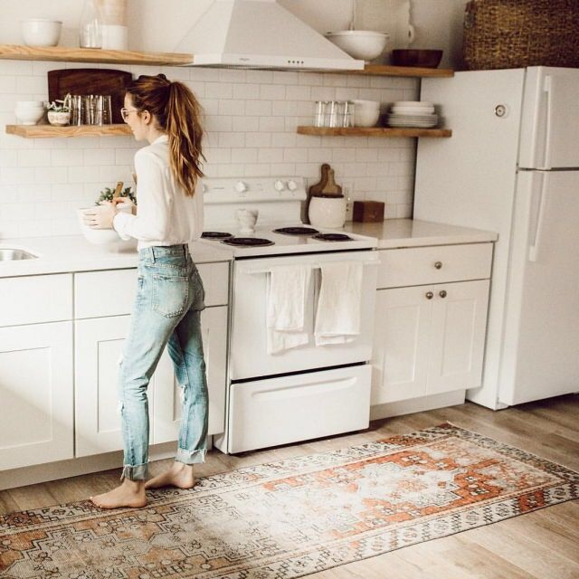 Tribal rug in kitchen with open wood shelving  Home