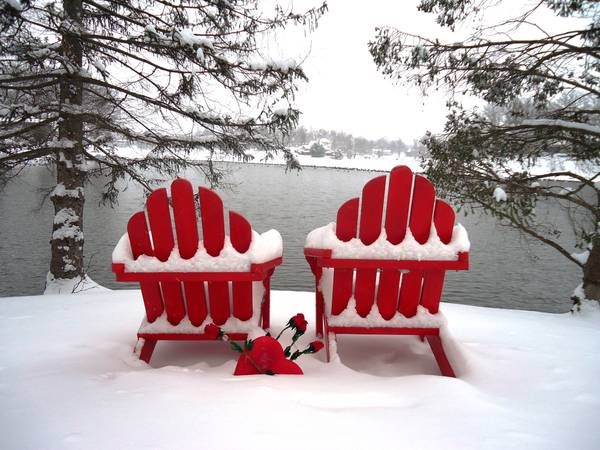 Lake loving in the winter Red adirondack chairs  Cottage