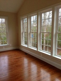 Sunroom wood floors & windows & vaulted ceiling