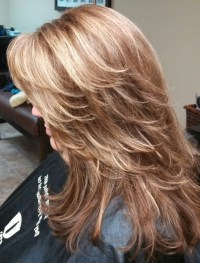 Red brown base color with heavy foils of caramel/ blonde ...