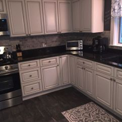 White Distressed Kitchen Cabinets Slice Rugs Mats Newly Renovated Kitchen. Features Include Travertine Back ...