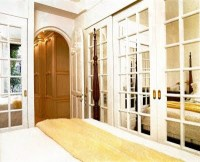 I adore the way these mirrored French door closet doors ...