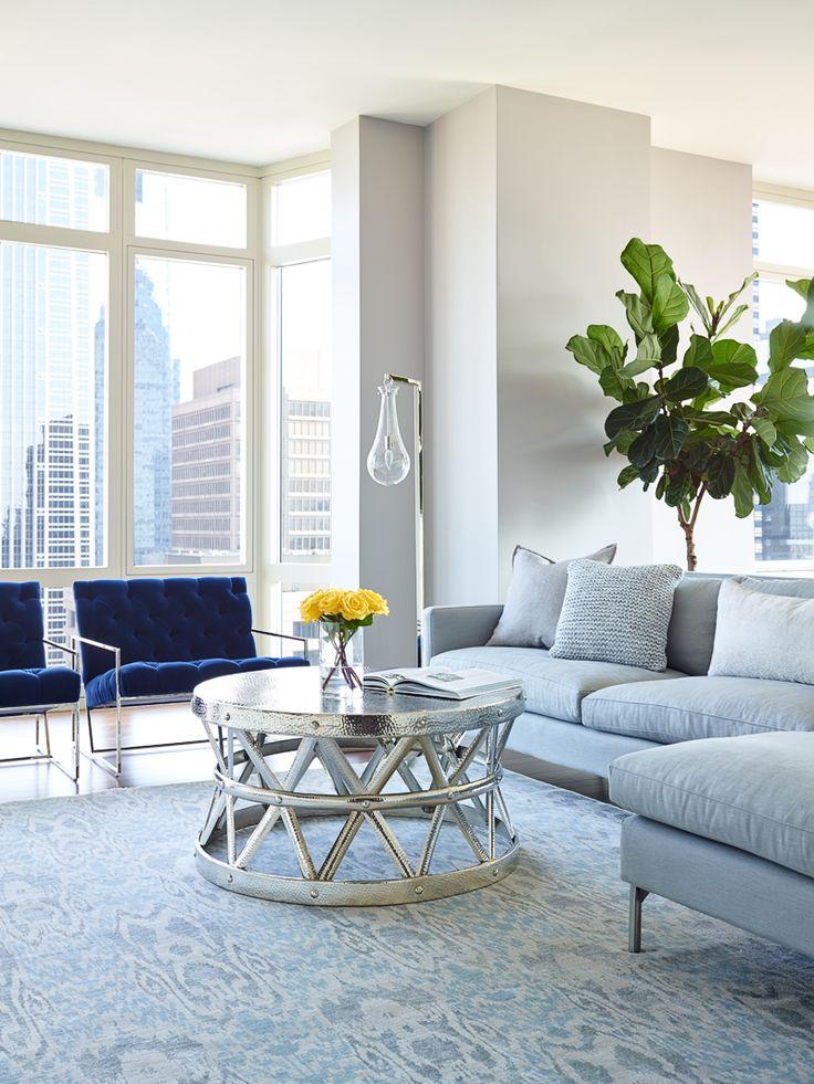 Blue Velvet Lawson Fenning chairs in high rise luxury