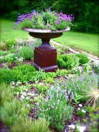 Simple herb garden with an urn as center piece - bird bath ...