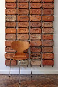 Antique bricks used as wall art. Very cool idea ...
