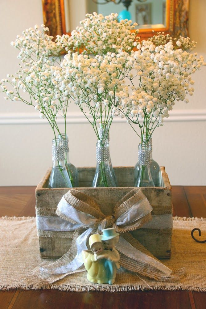 decorating wine bottles for bridal shower  Wine Bottle with Babys Breath Table Centerpiece