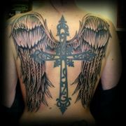 wicked tattoo cross and wings