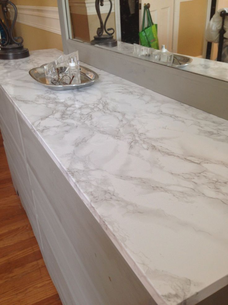 Faux marble contact paper covers damaged dresser top
