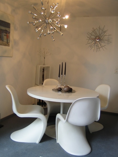 white panton chairs and white tulip table  Dining