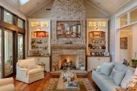 Country Living Room with Wall sconce, stone fireplace