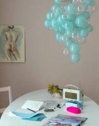 Whimsical chandelier invokes surprise and pleasure...light ...